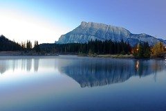 Dreamy Rundle (Explored) (John in Calgary) Tags: longexposure blue trees wild sky canada reflection green nature sunrise canon landscape ngc alberta banff geology habitat mountrundle nationalgeographic greatphotographers cloudsstormssunsetssunrises jpandersenimages