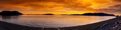 San Juan Islands Sunset (EdBob) Tags: sanjuanislands lummiisland legoebay orcasisland washington washingtonstate westernwashington panorama salishsea pugetsound pacificnorthwest sea ocean shore beach sunset orange red driftwood panoramic rosariostrait edmundlowephotography edmundlowe bay winter dramatic