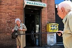 Show me what is in your handbag ... (tomavim) Tags: handbag stick oldlady redbrick oldman street pharmacy toulouse mailbox yellow red masonry bricks