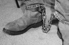 DSC_4889 (jakewolf21) Tags: bw monochrome chains cowboy boots jeans western soles cuffs chained ariat legirons