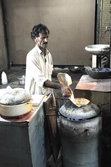Chappati Maker (Daudpota) Tags: pakistan food hot break oldman nightime hardwork islamabad gasfire chappati f10markaz chappatimaker unleavenedbreak