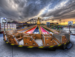 A fairground at sunset