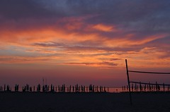 sunset on the beach (SS) Tags: camera pink light sunset red sea summer vacation sky italy orange beach water colors clouds composition contrast umbrella reflections skyscape photography evening colorful soft day mare mood glow dof view angle