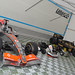 Lewis Hamitlon McLaren and Kart sit with Ayrton Senna Kart and our Lotus 98T