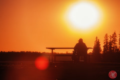 A man and his dog (Kasia Sokulska (KasiaBasic)) Tags: sunset sky dog sun lake canada man bench landscape nationalpark alberta elkisland astotin