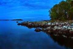 Hasseltangen (Birgit F) Tags: ocean longexposure blue trees sea lighthouse fall beach nature norway night evening norge twilight boulders hdr grimstad austagder fevik hasseltangen