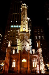 Chicago Water Tower illuminated at night, Illinois (Sir Francis Canker Photography ) Tags: trip blue sunset usa lighthouse lake chicago reflection building tower water skyline architecture modern night america skyscraper landscape lago illinois amazing arquitectura cityscape waterfront view d