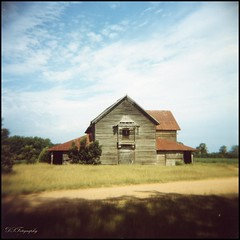 The Rushton Barn (dsfdawg) Tags: old history abandoned 120 film clouds barn rural ga vintage georgia holga big place kodak south country rustic historic southern abandon forgotten plantation weathered mansion portra decayed 120n olf oldsouth rushton