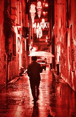 Red Light District (missgeok) Tags: lighting street red man art wet colors monochrome mystery composition reflections walking effects lightandshadows interesting mood colours shadows artistic pov path vibrant perspective sydney creative streetphotography atmosphere australia streetscene textures story rainy mysterious colourful framing puddles redlightdistrict laneways