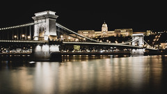 Szchenyi Chain Bridge (Juho Mkinen) Tags: budapest night cityscape city europe nikon sigma yellow bridge chainbridge chain water danube river hungary
