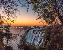 Sundown Over The Falls (MarcCooper_1950) Tags: waterfall victoriafalls wondersoftheworld water river sky zambia dramatic vivid hdr color fz1000panasonic lumix leica marccooper