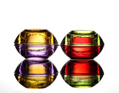 Jewels (Karen_Chappell) Tags: glass white reflection colourful multicoloured colours purple green red four stack yellow abstract stilllife