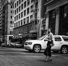 Urban Chic (TMimages PDX) Tags: woman crosswalk iphoneography photography image photo photograph streetscene fineartphotography geotagged people urban city street streetphotography portland pacificnorthwest sidewalk pedestrians buildings avenue road blackandwhite monochrome vignette