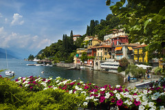 Bellano (oli.pickles) Tags: bellano lake water flowers buildings nikon sky italy holiday travel blue green white yello yellow boat pink d3200 como lombardy alps alpine foothills village town
