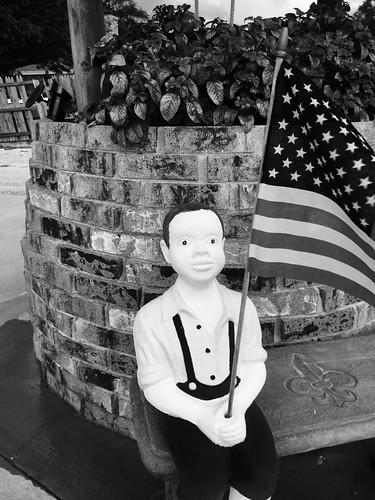 Boy statue with American flag