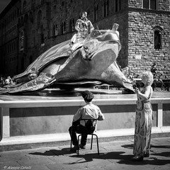 The Bodyguard (Alessio Catelli) Tags: the bodyguard street photography black white bianco nero bw bn man woman turtle florence firenze candid chair fuji xe1 xf1855 streetphotography