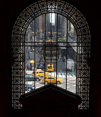 Meanwhile, Back At The World.. (MPnormaleye) Tags: city urban abstract cars window glass car architecture buildings arch traffic antique manhattan library patterns cities neighborhood textures transportation utata historical museums