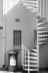 junk dna noir (Seakayem) Tags: urban blackandwhite bw detail window spiral 50mm stair noir minolta sony bin staircase canberra helix slt maxxum loadingzone wheeliebin f17 a55 melbournebuilding odgerslane
