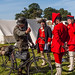 Timewarp - a WW2 German Werhrmacht cyclist chats with 18th century soldiers at a military reenactment in Romsey, Hampshire
