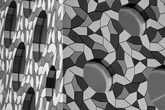 20120926_F0001: Patterned Ravensbourne (wfxue) Tags: city blackandwhite bw abstract reflection building london tourism window glass architecture triangles corner circle tile triangle pattern chaos order greenwich structure round pentagon attraction triangular chaotic irregular northgreenwich ravensbourne pentagons ravensbournecollege pentagonal ravensbournecollegeofdesignandcommunication