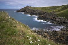 Rugged Coast (manphibian) Tags: porth nefyn morfa cymru wales coastline lighthouse golf course rugged rocks sea blue water clear beach cliffs sony sonya7 sigma 24105 art
