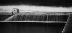Angry sea curtain call  (Explored) (OzzRod) Tags: pentax k1 smcpentaxda55300mmf458 sea waves surge swash waterfall longexposure water flow movement blackandwhite monochrome newcastle oceanbaths