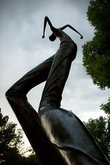 Break A Leg (Wirdlig) Tags: sculpture colorado loveland benson bensonsculpturegarden man standing tall art photography abstract eclectic dusk park bronze statue dancing dancer toddkurtzman legs