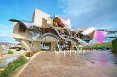 Bodegas marques de riscal (davidherraezcalzada) Tags: wine cellar winery design building gehry spain architecture viticulture modern alava mediterranean marques landmark spanish steel shapes larioja rioja riscal outdoor museum attraction curve contemporary bodega city construction elciego euskadi araba hotel basque exterior industry storage rural alcohol valley drink basquecountry titanium metal marquesderiscal frankgehry outside metallic business industrial frank