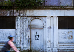 Derelict building, Liverpool (Matthew Usher) Tags: liverpool abandoned grafitti derelict mersey cyclist symmetrical symmetry architecture door outdoor