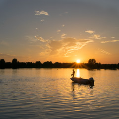 Watching on (Russell Discombe) Tags: lifeguard swimmers sunset sun boat sky evening goldenhour gloucestershire southcerney lake water yellow outdoor landscape nikon nikond3300 sigma18250 sigma silhouette