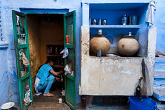 Kitchen, Jodhpur (Marji Lang Photography) Tags: life door family blue people woman india house color home cooking kitchen colors girl azul composition cuisine glasses bucket colorful tea couleurs indian daughter cook daily bleu pots framing dailylife blau teatime indien chai jars rajasthan