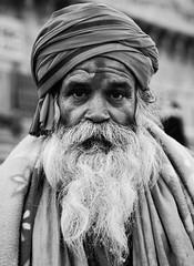 Man posing Varanasi prayer ghat (Rob Whittaker Photography) Tags: india man prayer north posing varanasi ghat 2011 northernindia robertwhittaker sazzoo robwhittaker