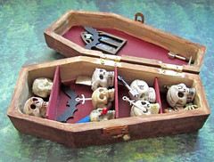 Miniature Coffin Closet Filled with Skulls ~1:12th Scale (Enchanticals ~I'm Coming Back) Tags: brown halloween dark dead skulls miniatures miniature noir handmade maroon clown gothic cream spooky fantasy horror etsy coffin shelves murdered weapons gory angelofdeath halloweendecor 112thscale dollhouseminiature onetwelfthscale etsyteams damteam teammids enchanticals minitreasures enchanticalsetsy miniaturecoffin flickrawardgallery
