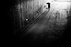 Into Darkness.. (Peter Levi) Tags: street city blackandwhite bw woman blancoynegro umbrella sweden stockholm streetphotography documentary x100 fujifilmx100 fujix100