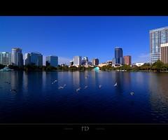 Downtown Orlando (Fabdub) Tags: park travel usa lake tower clouds orlando downtown tour pentax florida reflet ciel hdr floride amricain tatsunis lakeeolapark pentaxart pentaxk7