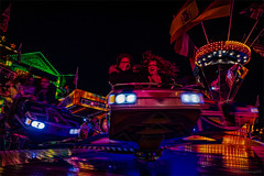 Fun in red ([P]hotogr[AV] (on/off)) Tags: longexposure nightphotography nijmegen lights cityscape nederland thenetherlands fair kermis nachtfotografie waal gelderland landen stadsgezicht