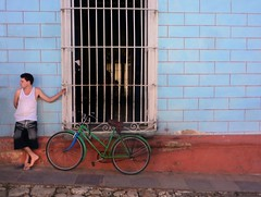 Wait for now.. (areyarey) Tags: street travel blue summer urban man color detail building window look bike bicycle wall facade vintage relax town stand waiting colorful warm exterior looking cuba colonial entrance retro sidewalk trinidad tropical wait caribbean typical cuban picturesque leaning chill areyarey