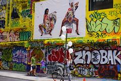 The street art on yellow wall @ Delancy, NYC (Xu@EVIL Cameras) Tags: new york city summer berlin art 35mm voss f28 exakta delancy streetshooting piesker