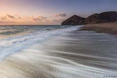 Beach Of The Dead. [Explored & FP 09-02-2016] (dasanes77) Tags: canoneos6d canonef1635mmf4lisusm tripod landscape seascape dawn sunrise sun beachofthedead waves sand longexposure reflections shadows orange