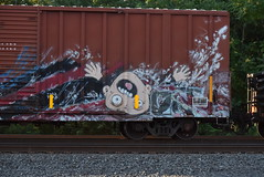 ? (TheGraffitiHunters) Tags: graffiti graff spray paint street art colorful freight train tracks benching benched face falling weird boxcar