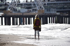 Lost in this world (Pics4life.nl off and on next week) Tags: lonely woman beach strand vrouw eenzaam wheel waves golven sea zee scheveningen pier netherlands nikon sigma colorful
