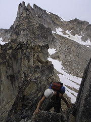 The Bugaboos - Alana Scrambling Eastpost Spire (Tideline to Alpine Photo, Idiosyncrasy Exemplified) Tags: camping sky snow mountains expedition clouds hiking spires adventure climbing alpine mountaineering wilderness scrambling alpinism bugaboos thebugs alpineclimbing bugabooprovincialpark applebeecamp applebeedome eastpostspire