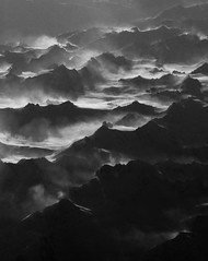 Layers of Wonder (cormend) Tags: mountains fog alaska clouds canon airplane landscape eos flight 50d cormend