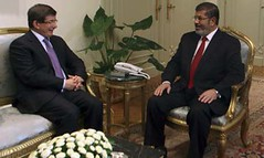 Egyptian President Mohamed Morsi on a state visit to Turkey holds talks with Foreign Minister Davotoglu. The new president has been traveling around the world. (Pan-African News Wire File Photos) Tags: with president egypt foreign turkish minister morsi davotoglu