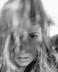 335/365 through hair (pukilin) Tags: portrait bw selfportrait eye face 35mm hair ojo dof bokeh retrato cara autorretrato pelo project365 i nikond3100