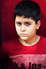 Red (Alias_239) Tags:         iran qom portrait kid window look