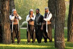 Praying Men (Canon Queen Rocks (1,000,000 + views)) Tags: men singing traditions praying park sunset trees