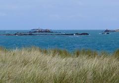 Like a Fata Morgana (evakatharina12) Tags: herm island grass sea beach channel water lighthouse landscape sky britain panasonic fz1000 outdoor