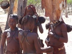 Girls in Traditional Attire, Goatskin Hanging on Tree Branch, Otjikandero Himba Village, Kunene, Namibia (dannymfoster) Tags: africa namibia otjikandero himbavillage otjikanderohimbavillage people africanpeople himba girl himbagirl