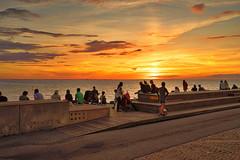 Sunset Vstra Hamnen (ULundquist) Tags: vastrahamnen sitting water sunset boardwalk hdr people malmo sweden outdoor walking evening orange sea malm